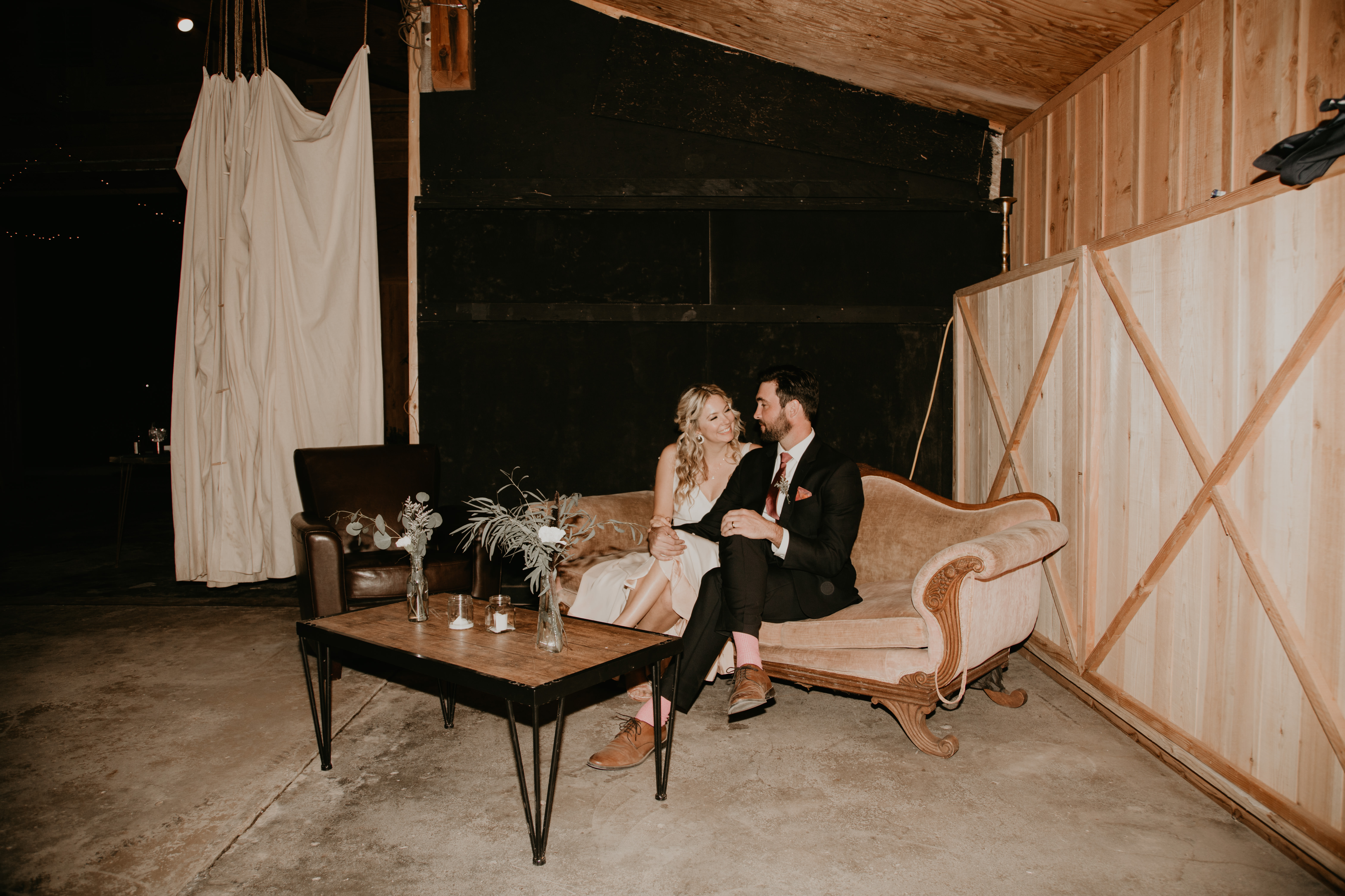Bride and groom portraits on couch in Pioneertown Wedding, photo by Fatima Elreda Photo